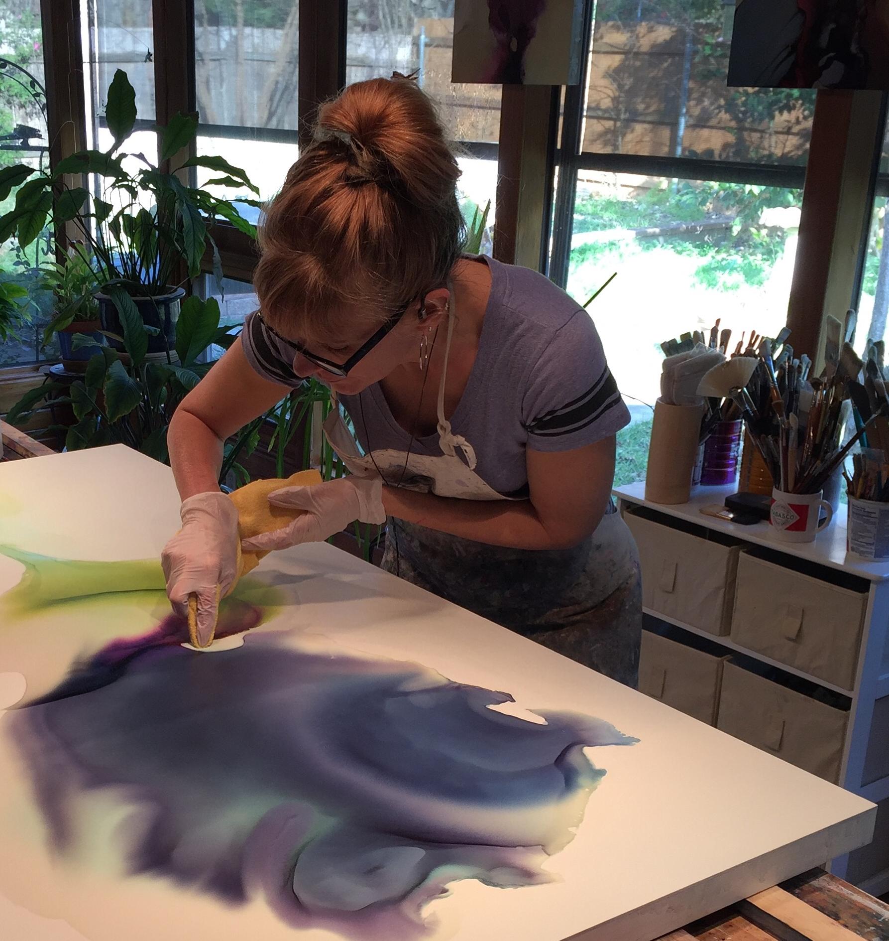 "Andrea Pramuk in studio, working on  Tethered , 30""x60"", 2016"