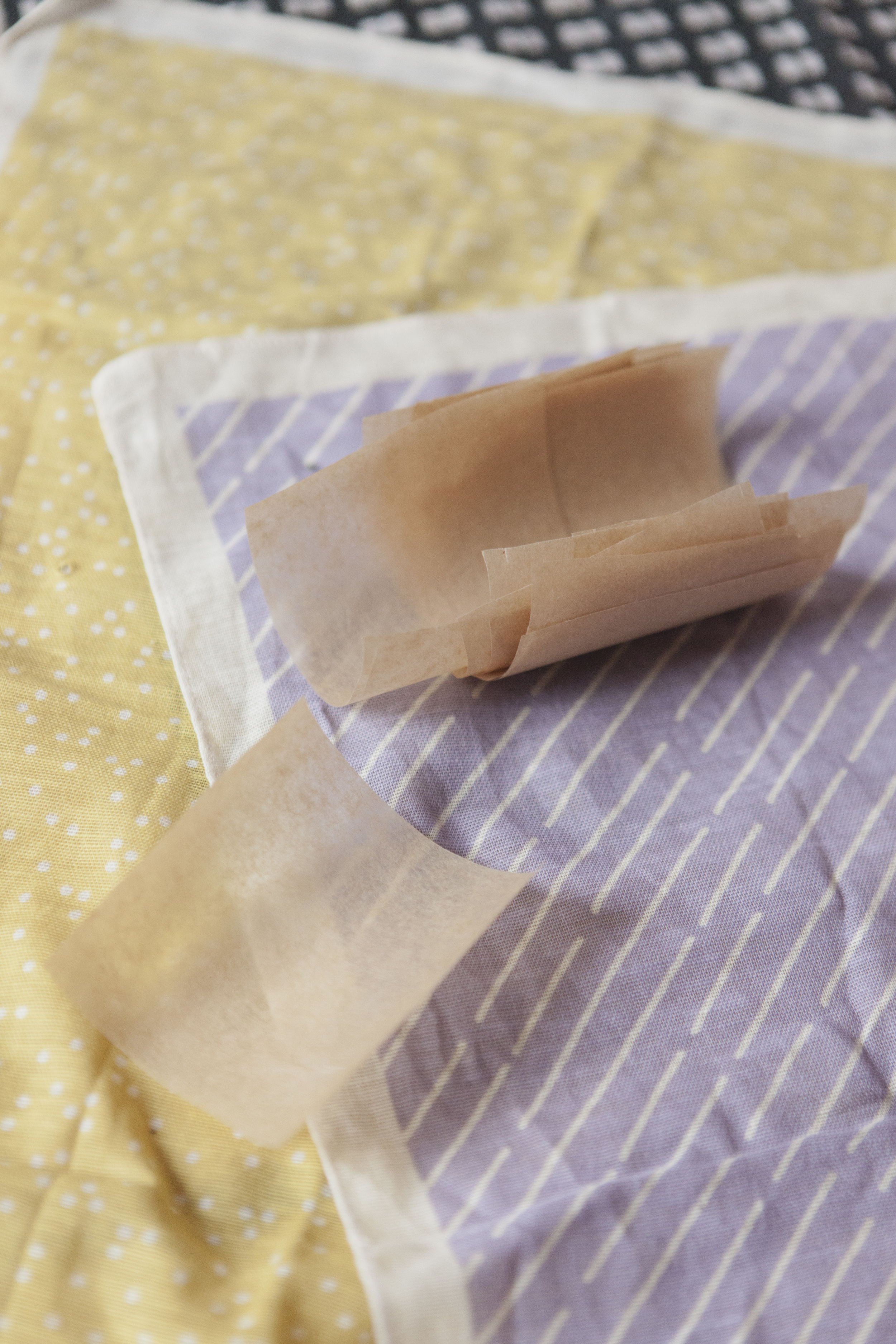 Make little squares of parchment paper for the steamer while the dough is rising.