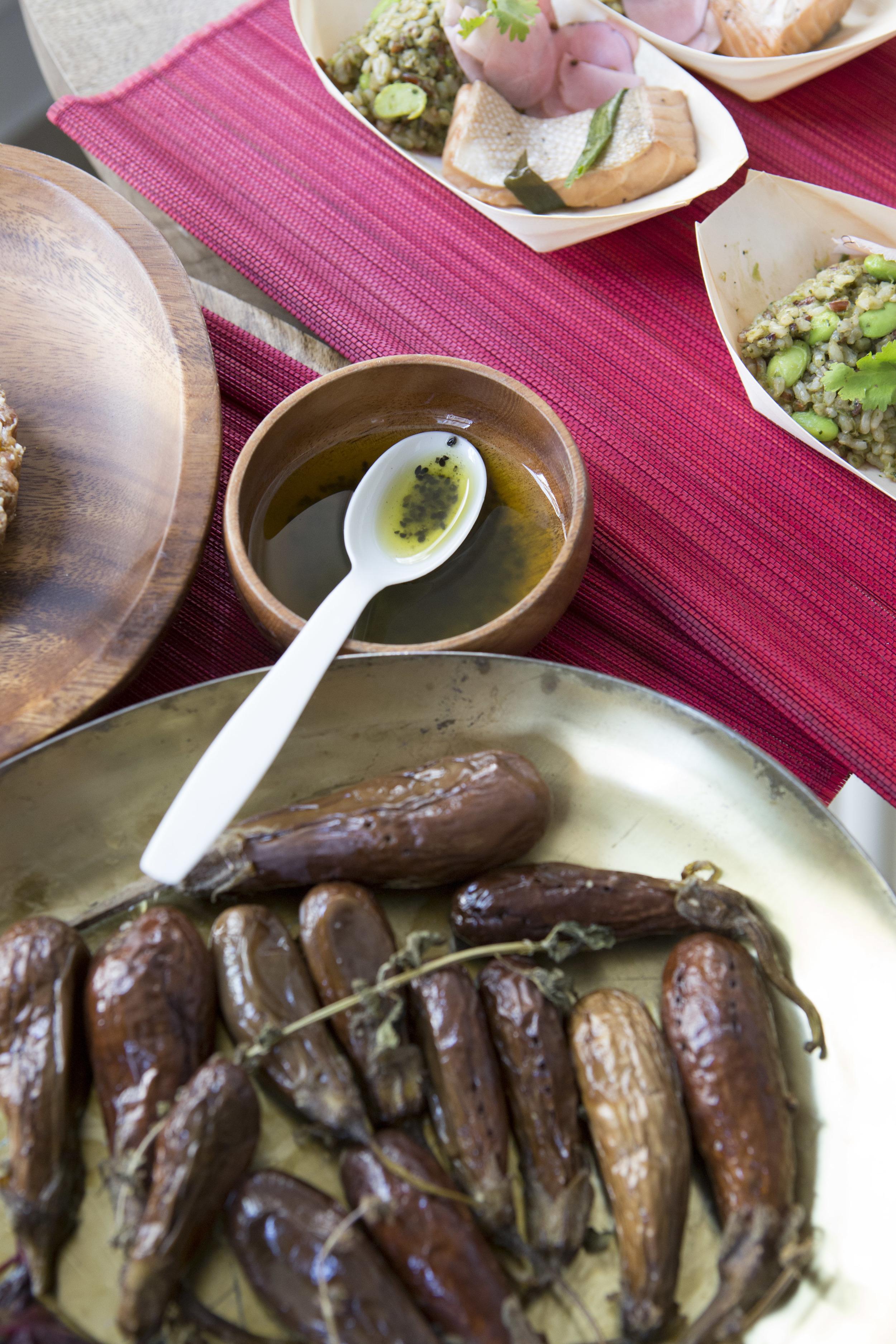 Market fresh tiny eggplant roasted with lemon basil. Black sesame lemon dressing in the back.