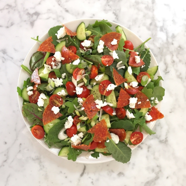Pizza Salad - Pepperoni (from humanely raised pork) tomatoes, cucumbers, green onion, feta cheese, arugula and baby greens. Oh man - I just thought of adding olives to this delight...