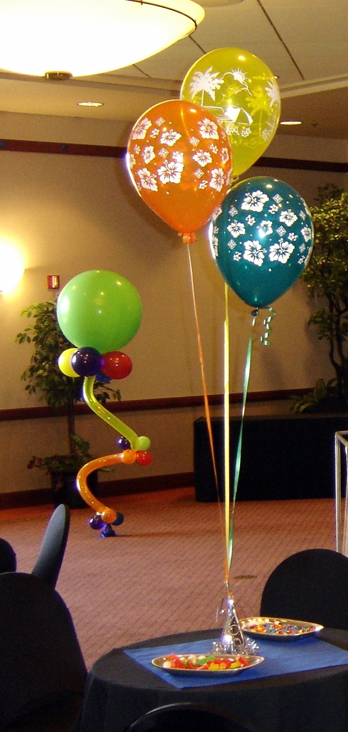(Left: Twisted Balloon Sculpture = $50) (Right: Bouquets of three 11' balloons, weighted = $10))