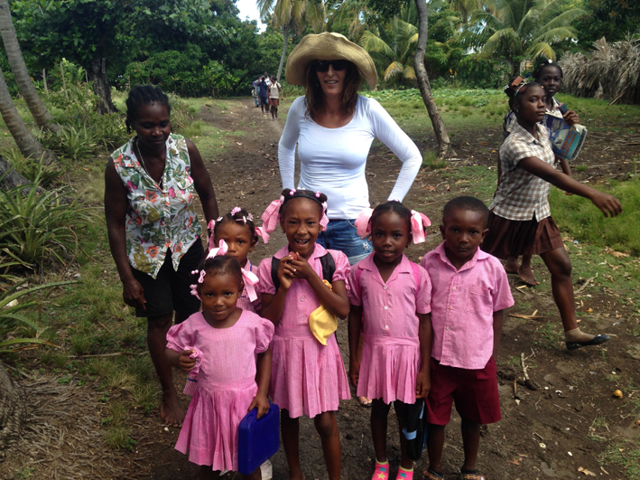 Alex with school children in Haiti 2014