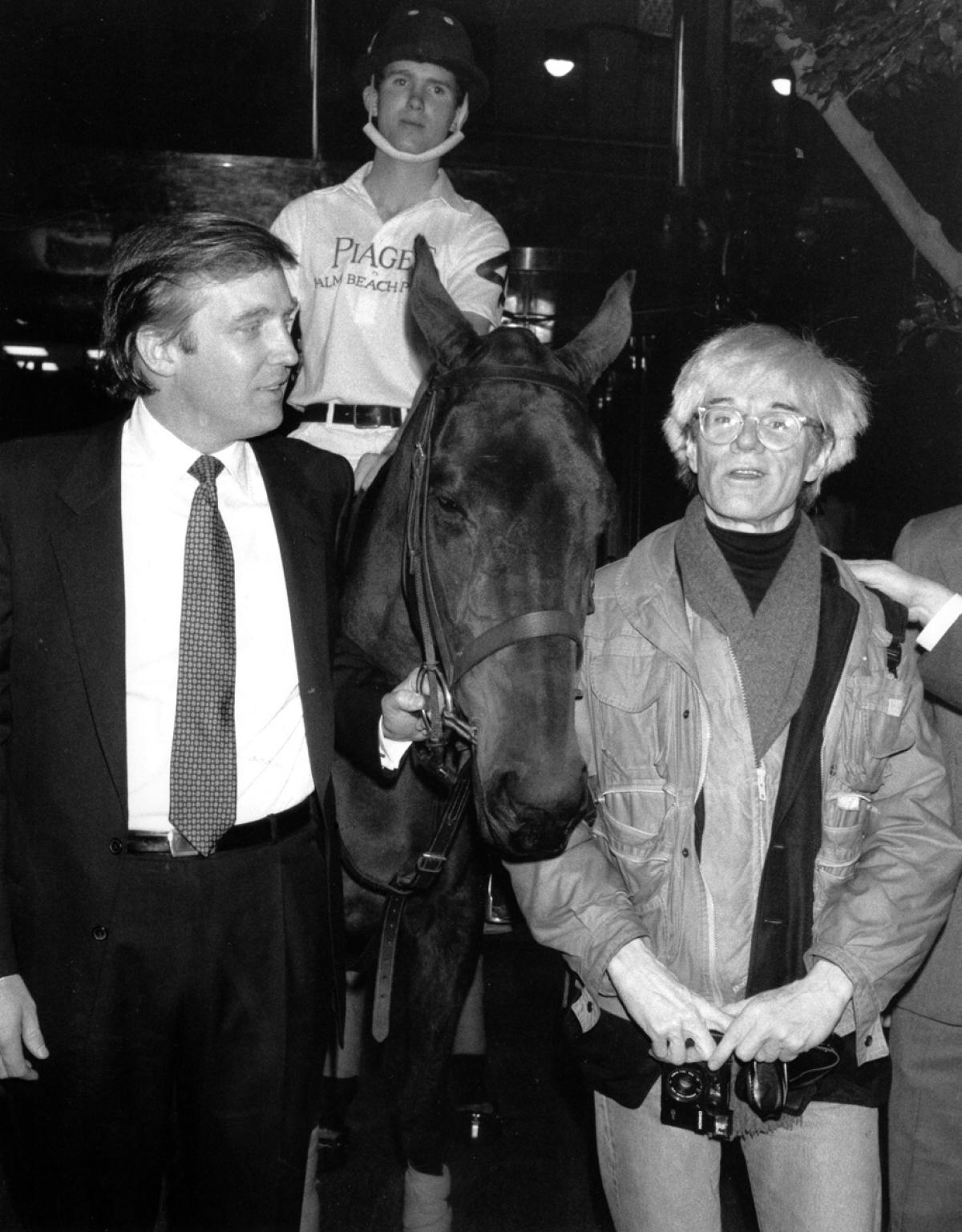 Andy Warhol and donald trump in 1983 with a race horse. i can't get off of a horse race theme here. america loves a winner.