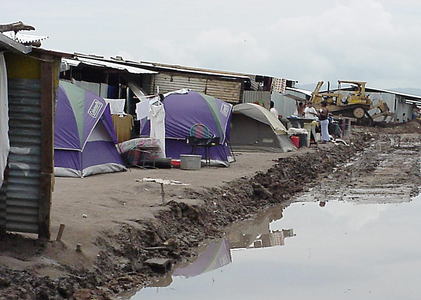 The tent city that people lived in before the new community was built.