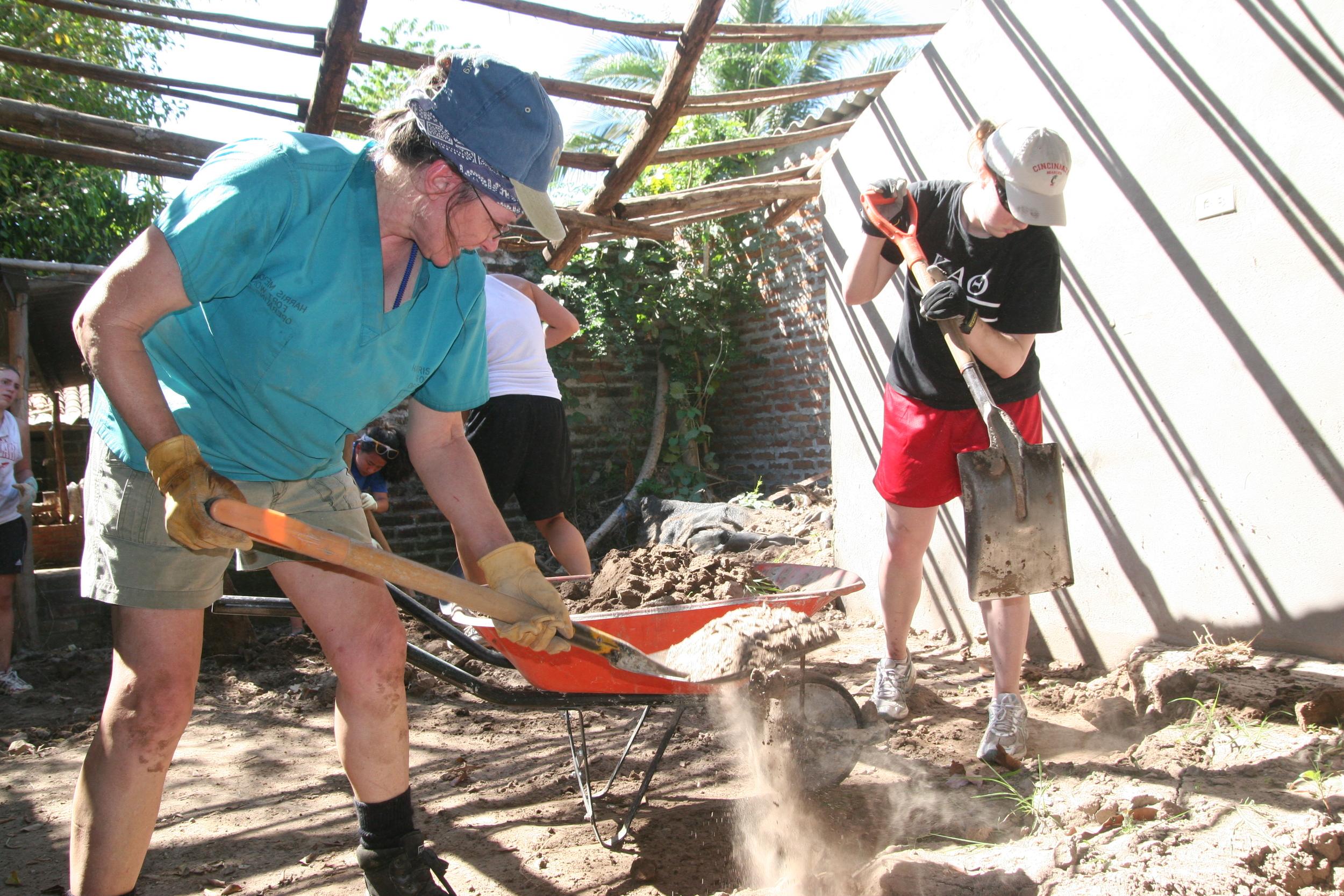 Carla Kessler removes sand from a home in Santa Cruz.