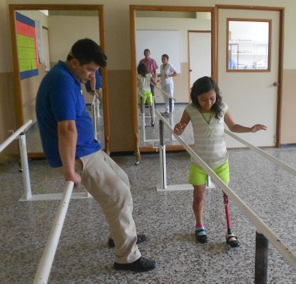 Blanca tries out her new leg at Don Bosco University in San Salvador.