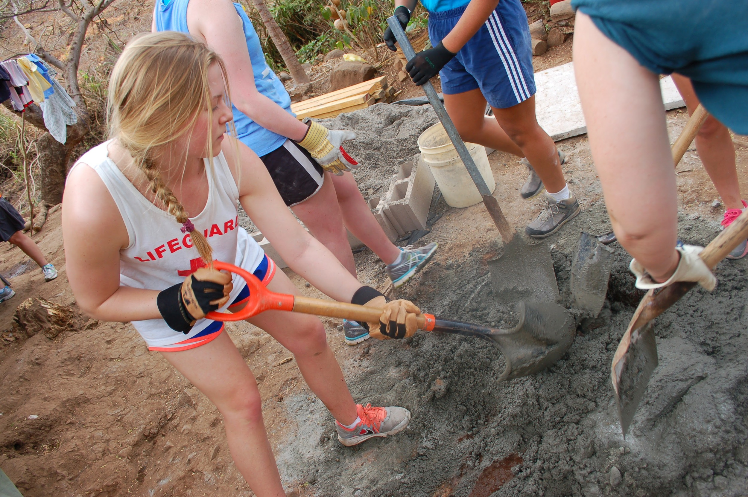 Mixing cement by hand for the latrines (photo credit: Jennifer Greene)