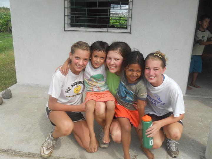 Siobhan, Shaughnessy, and Keara Miller with Salvadoran children during their family trip.