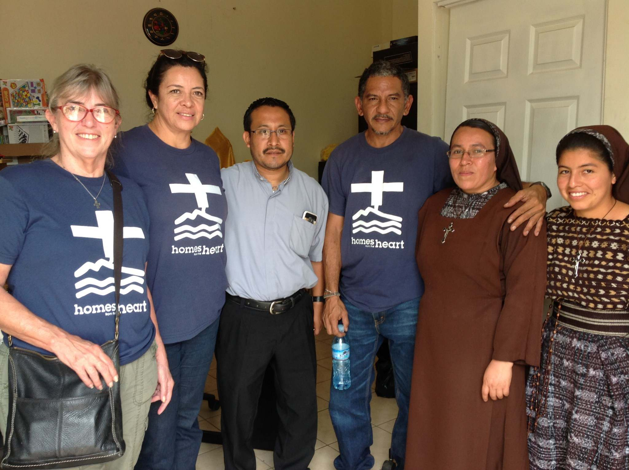 Homes_ staff with Padre Geraldo, paster of Our Lady of Guadelupe, Sr. Rosita and a young novice nun.jpg