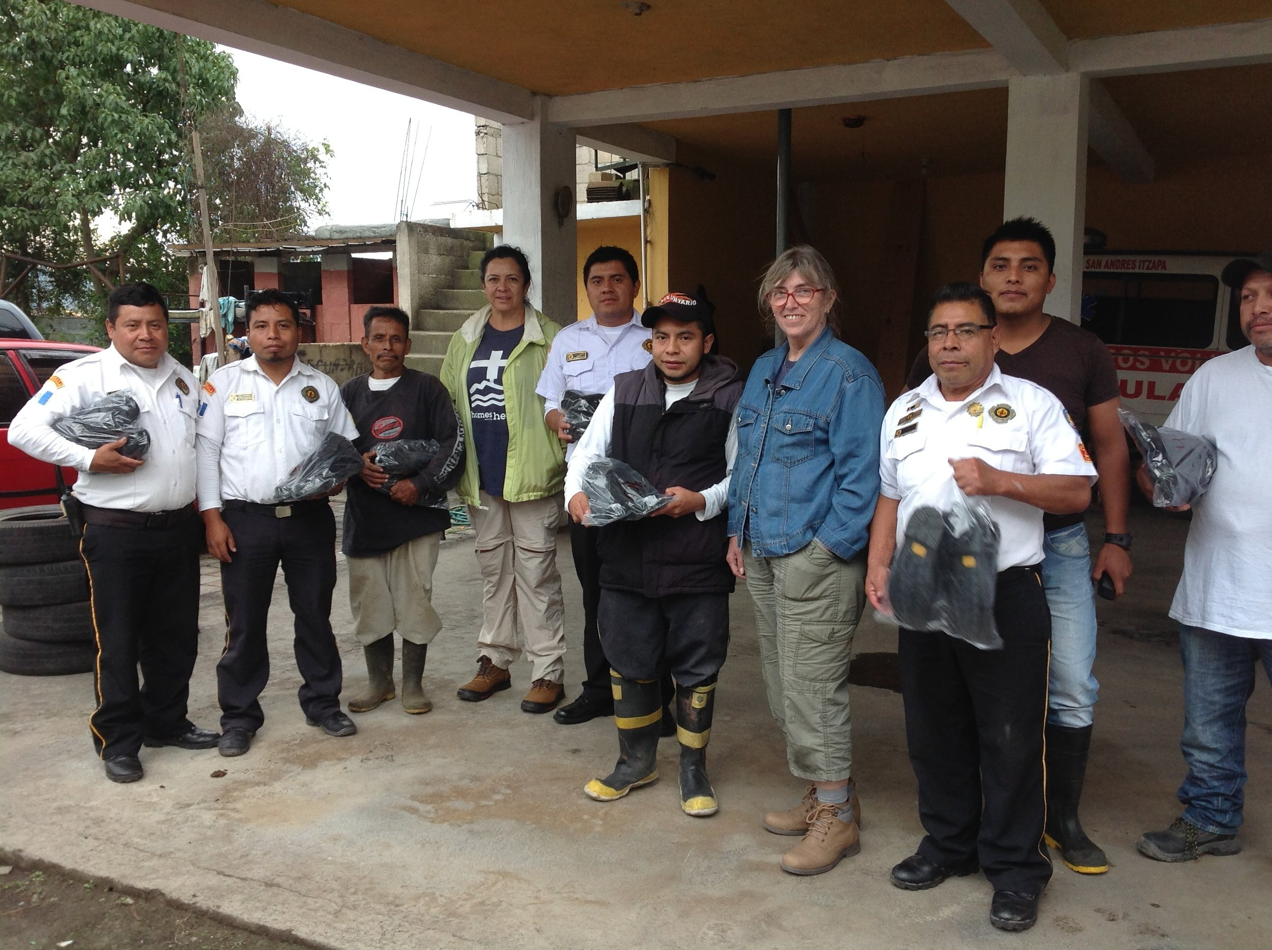 Some of the firemen and volunteers at San Andres Itzapa with new boots.jpg