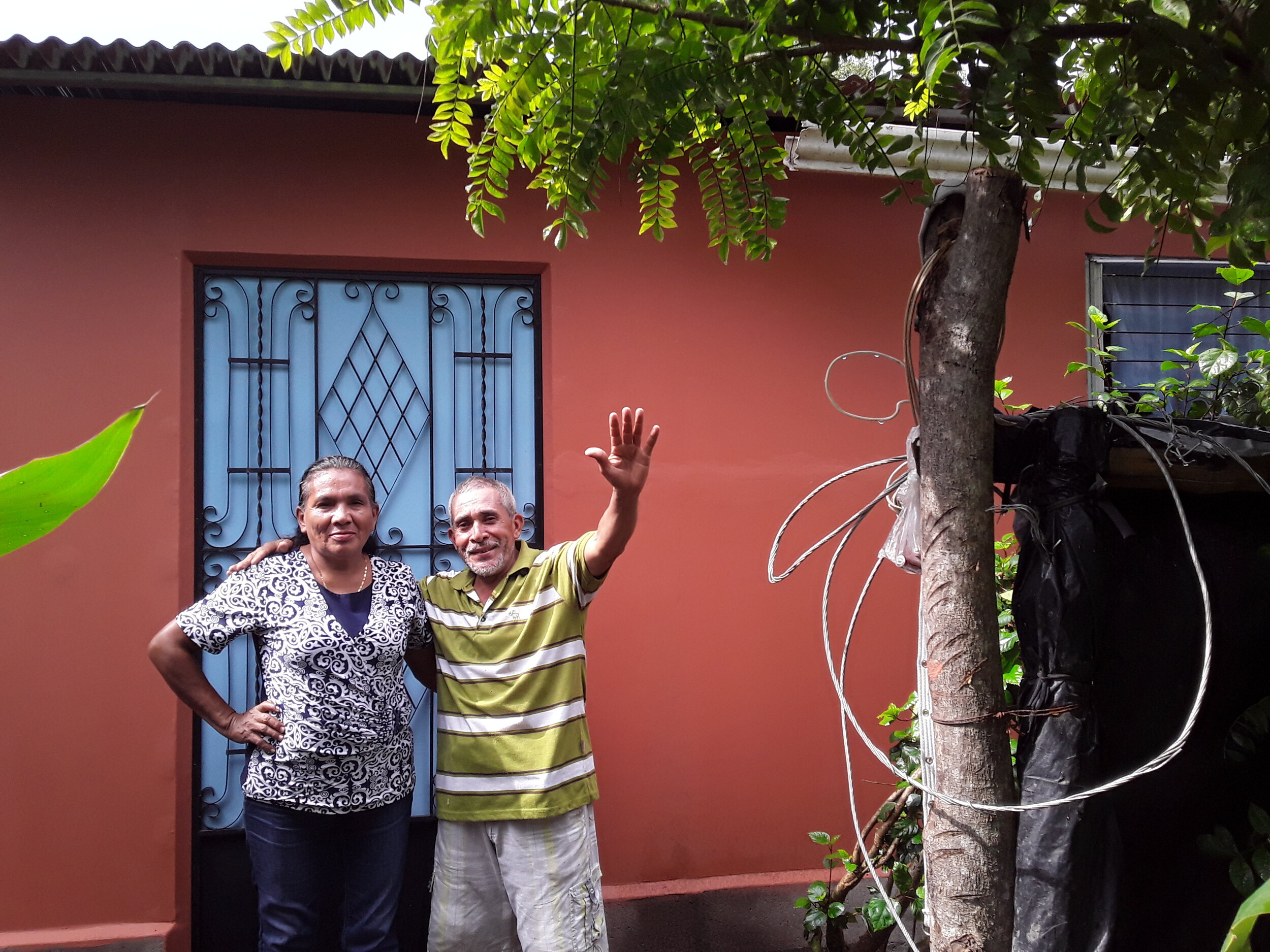 Greetings from El Salvador! This is Jose & Rosa Guzman, standing in front of their new home!