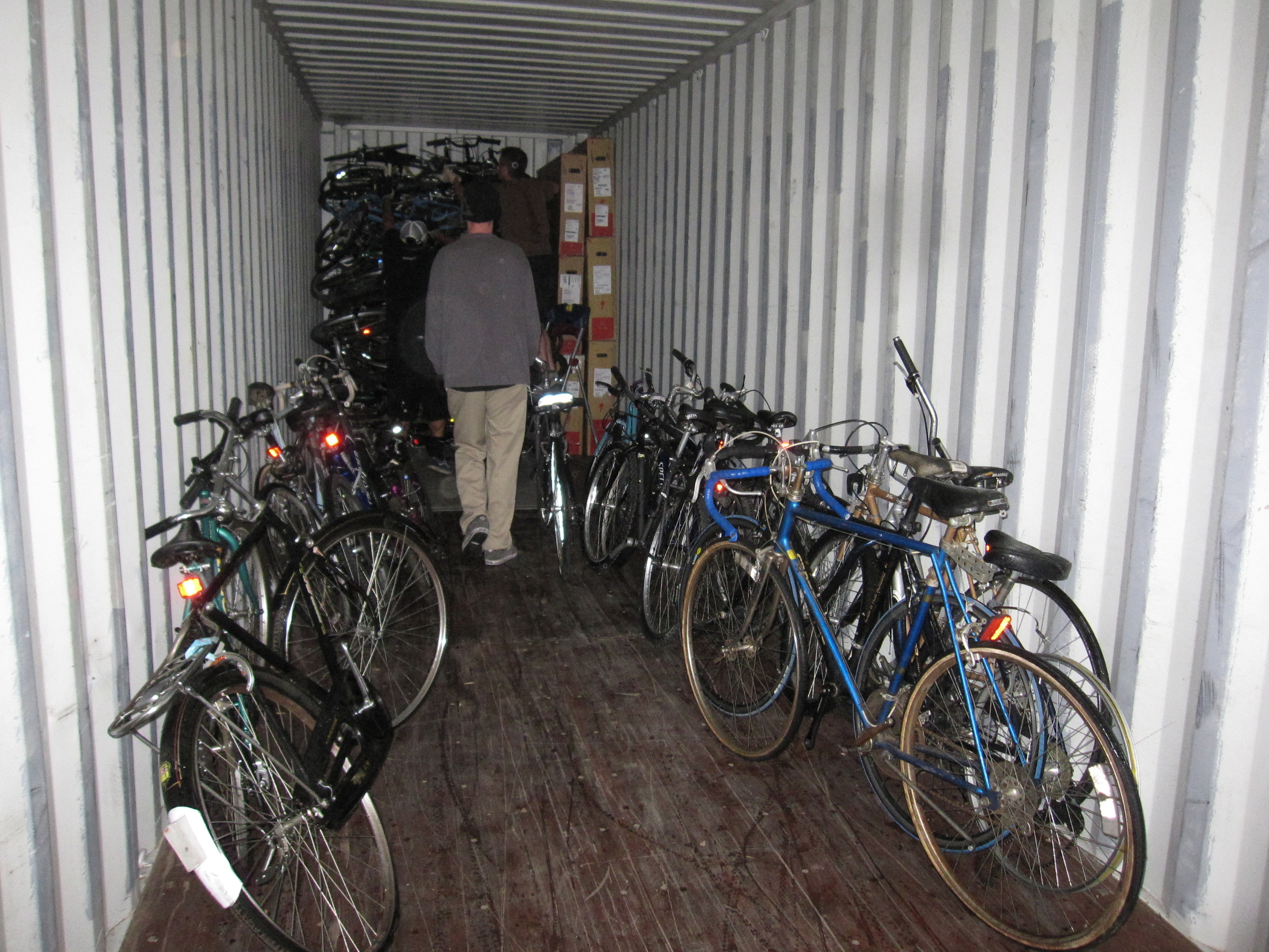 The first stack is done in the nose of the container. Bikes are staged along the sides of the can, so the loaders can select the bike that will fit best in a particular spot - like Tetris.