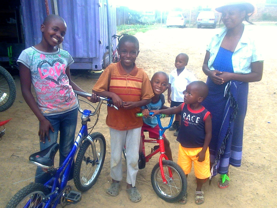 Tumi noticed this lady and her kids near the bike shop and reached out to them with donated bikes.  Needless to say, they're stoked!