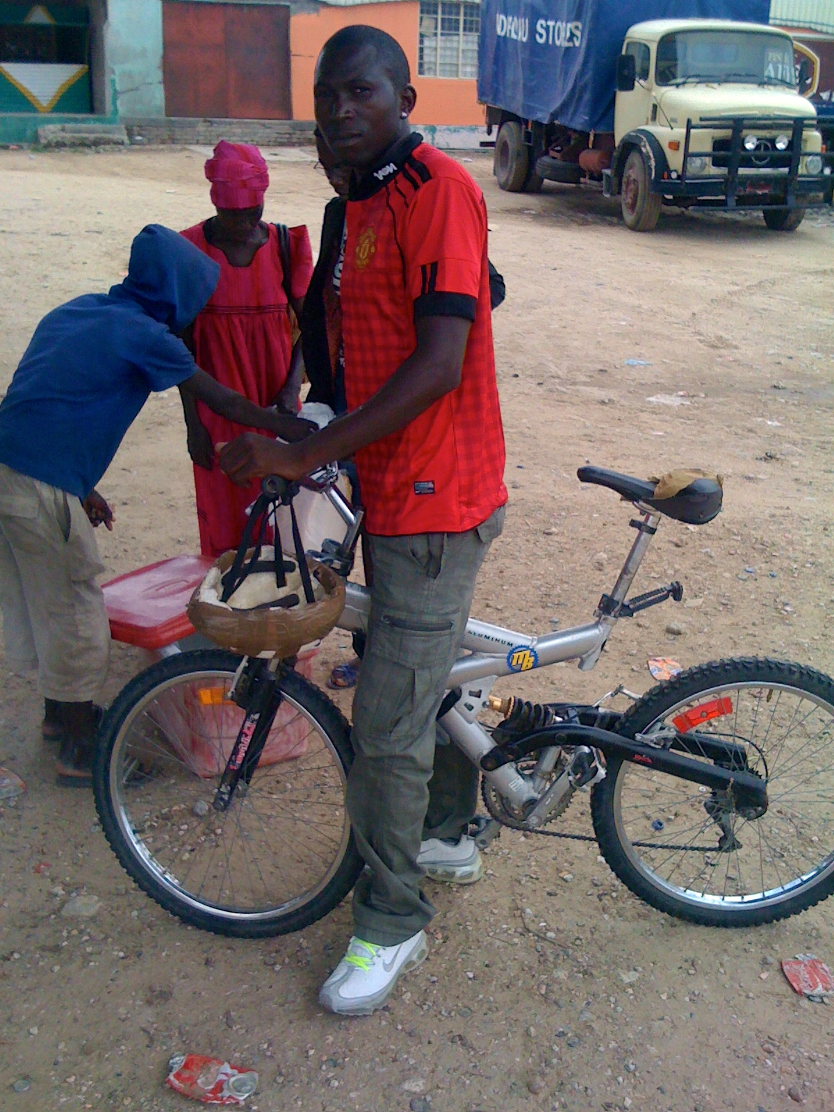 At the market in town, Paul just happened to find this guy on a bike with an MB sticker on it. So cool!