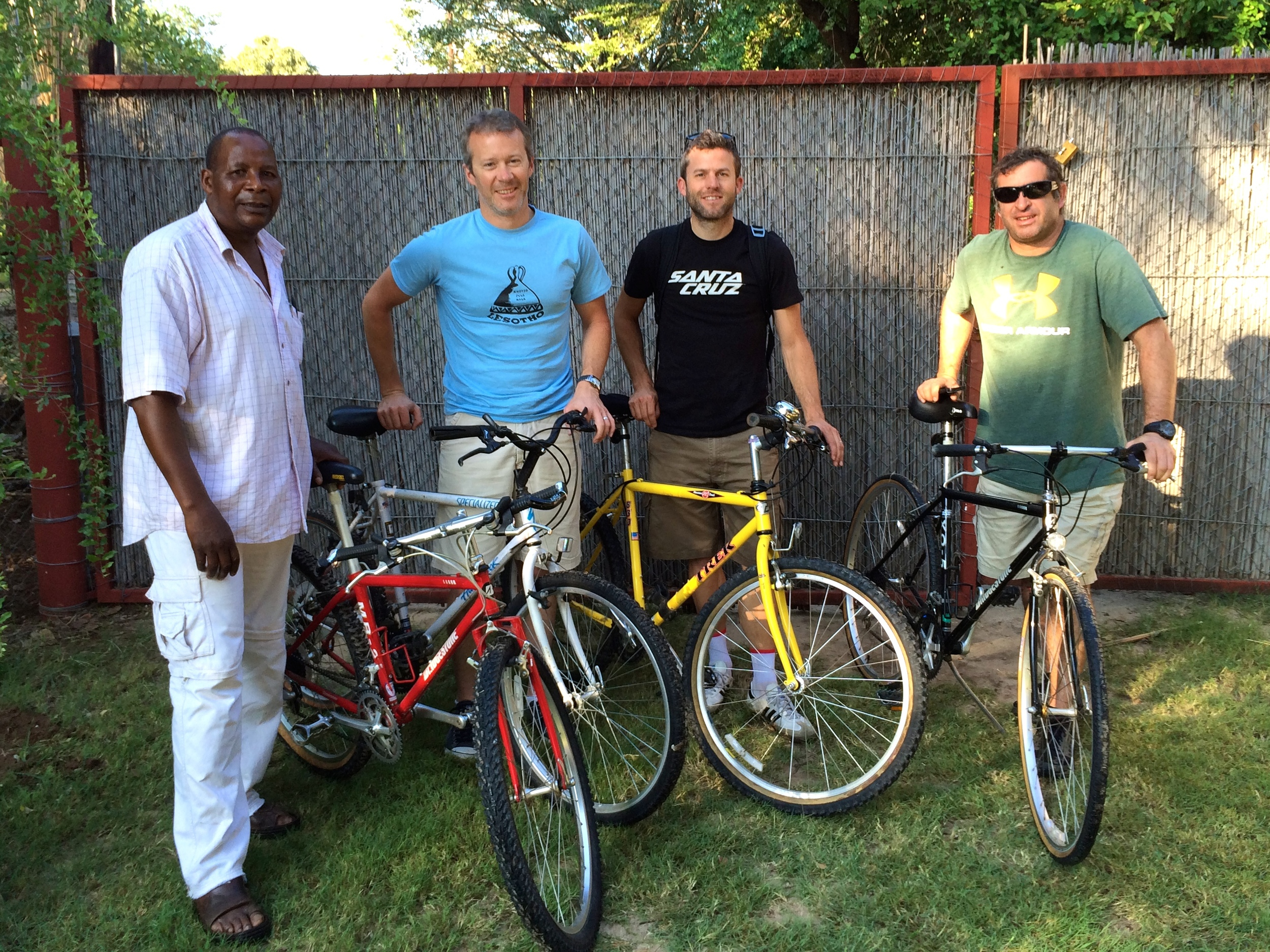 Trinos with Ken, Matt and Paul, and a few of the bikes he has available for sale in Shakawe.  They've made a long long journey from California.