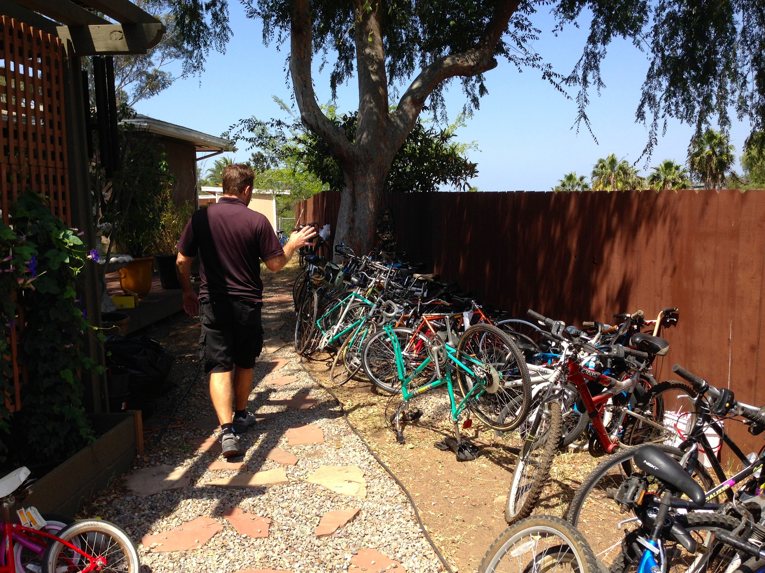 Mike giving a tour of the donation bike piles.