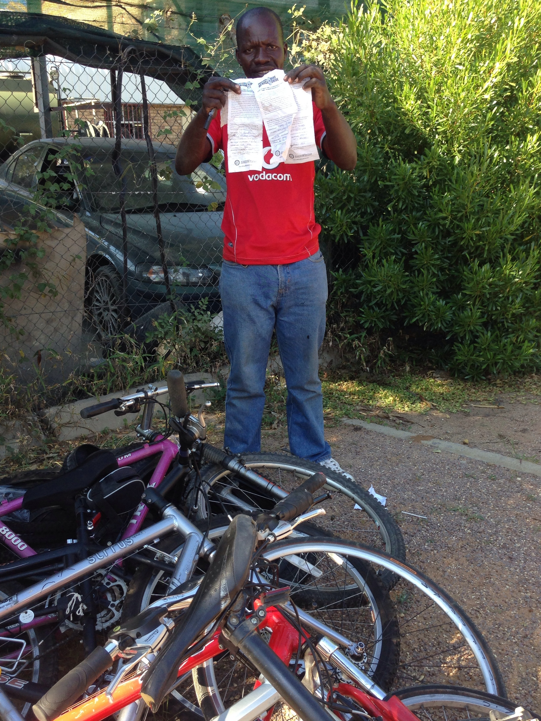 Lovemore with his new stock and slips from our bike donors in California.