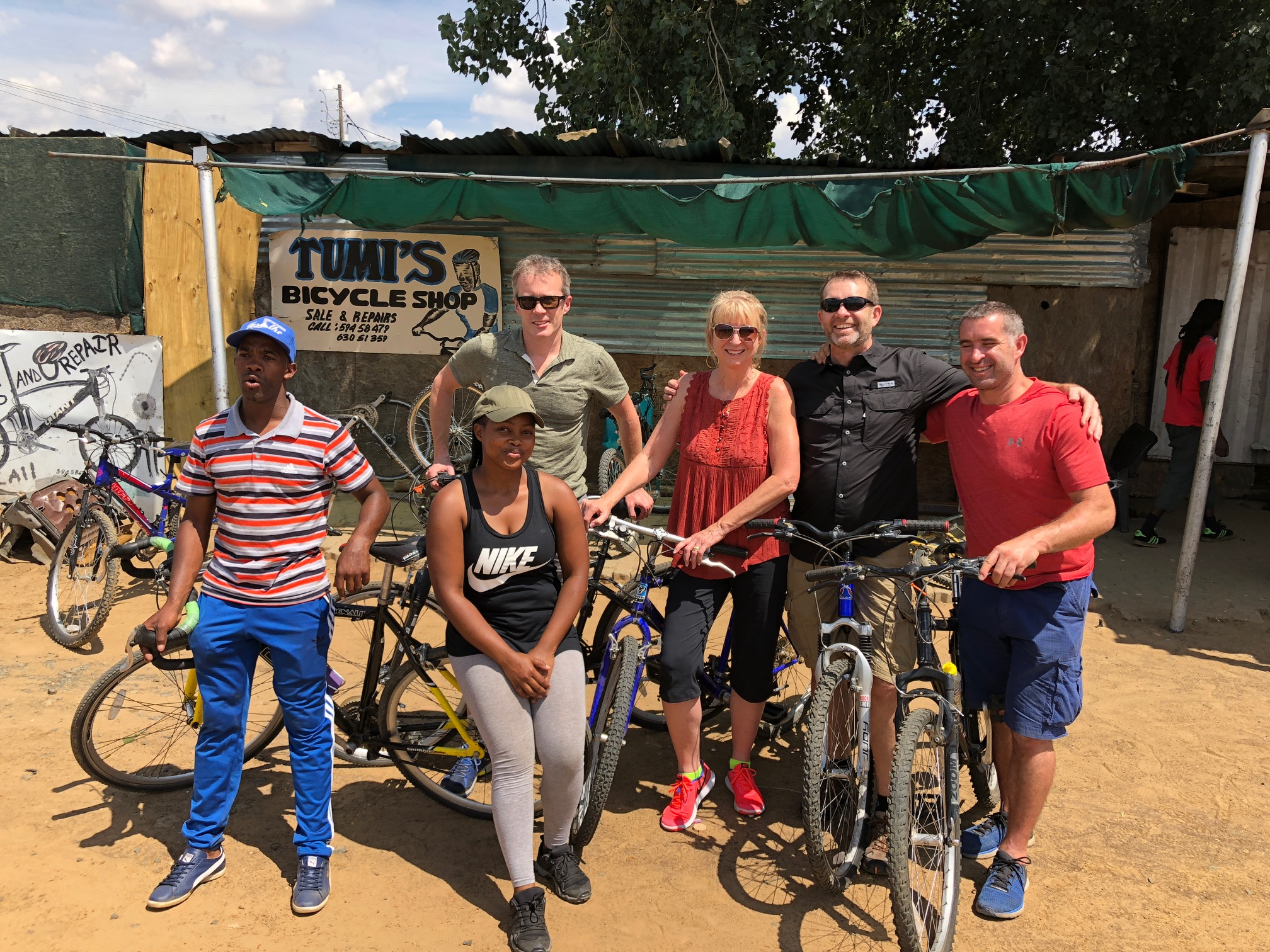 DELIVERING BIKES - Ken, Mike's Bikes CEO, with Mike & Debbe, Bicycle Warehouse Owners, visiting Tumi's Bicycle Shop, one of Mike's Bikes Sister Shops, in Lesotho during their recent trip delivering bikes.