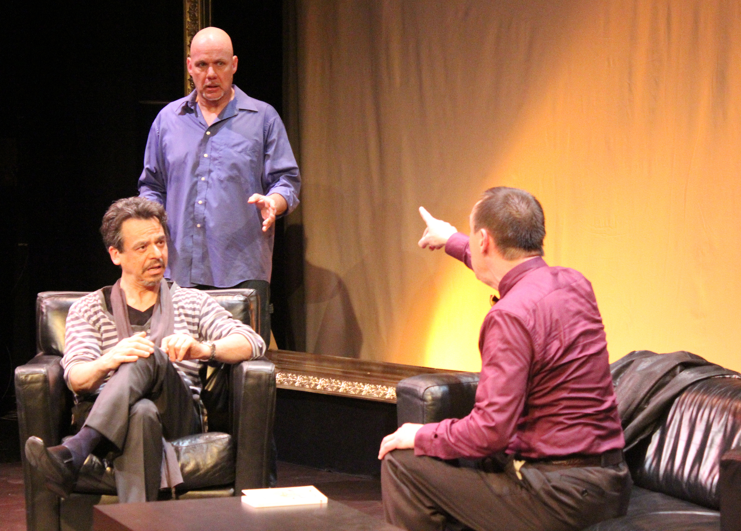 Marc (David Frisch, left) and Yvan (Andy Massingham) take a point from Serge (Robert Marinier) in   'Art'    Photography by Julie Le Gal