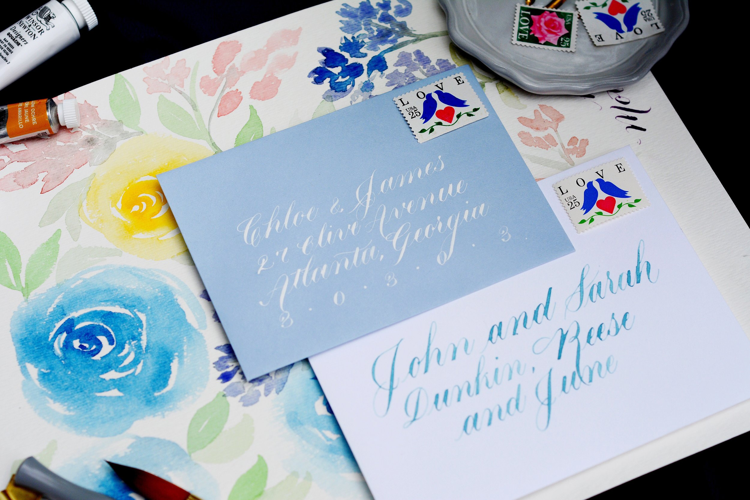 light blue and white calligraphy envelopes