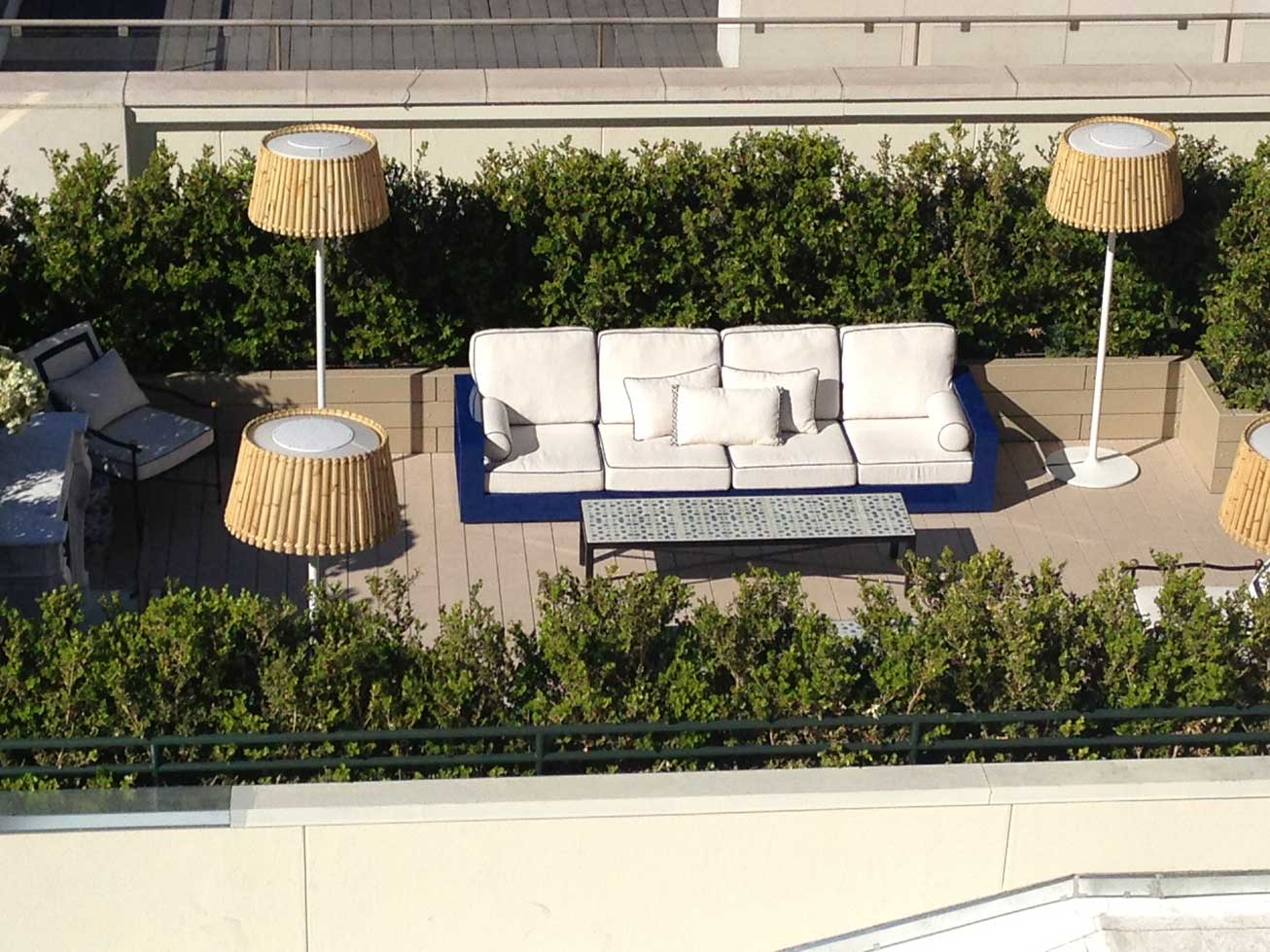 View from the Luxe Hotel looking down on the Chanel rooftop. Check out that cool outdoor living room.