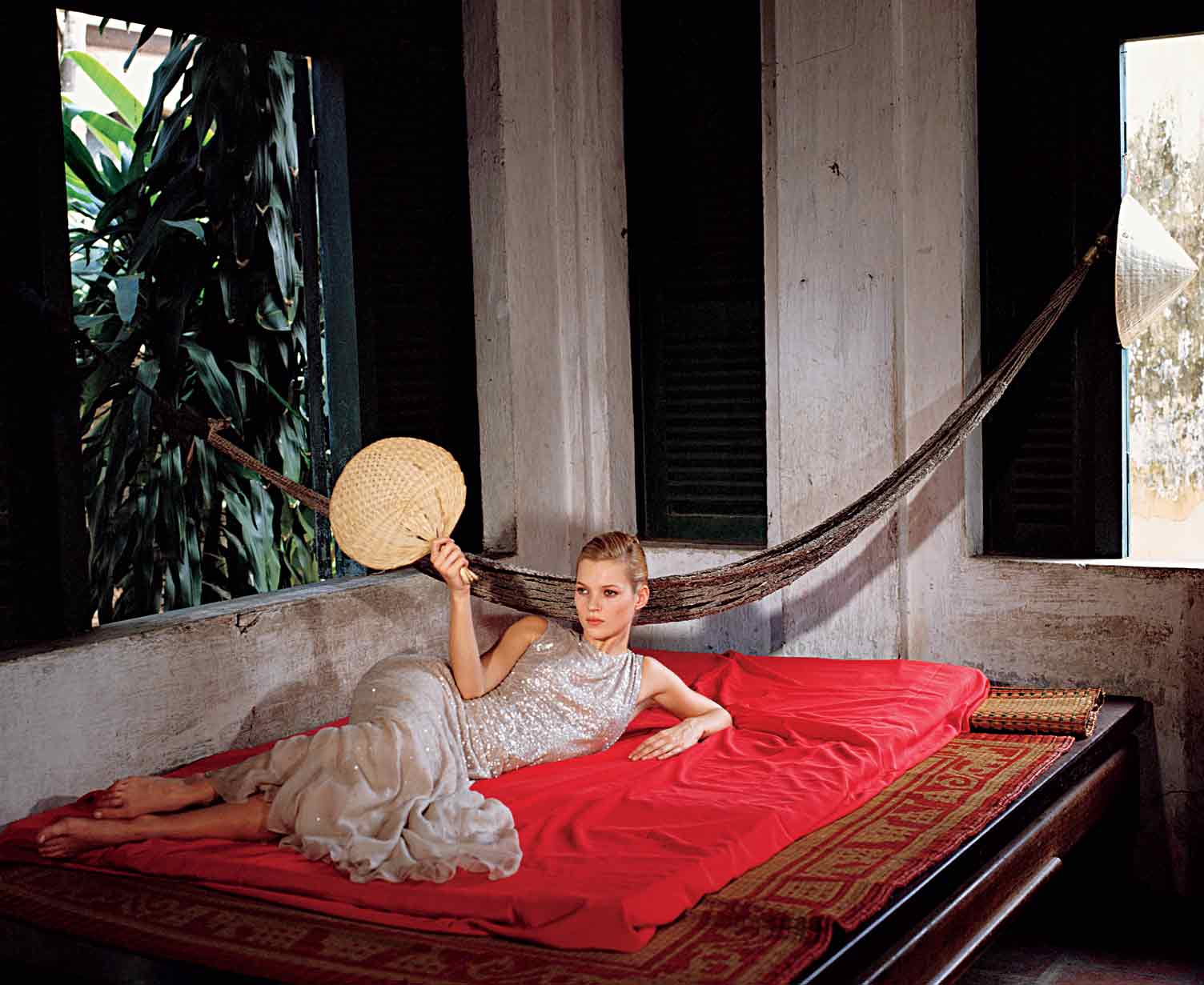 Kate Moss in an Oscar de la Renta bias-cutsilk chiffon dress, 1996. Bruce Weber /Vogue,  © Condé Nast