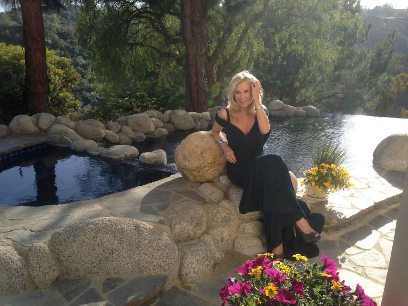 Donna Antebi wearing Donna Karan at her Bel Air home overlooking Los Angeles