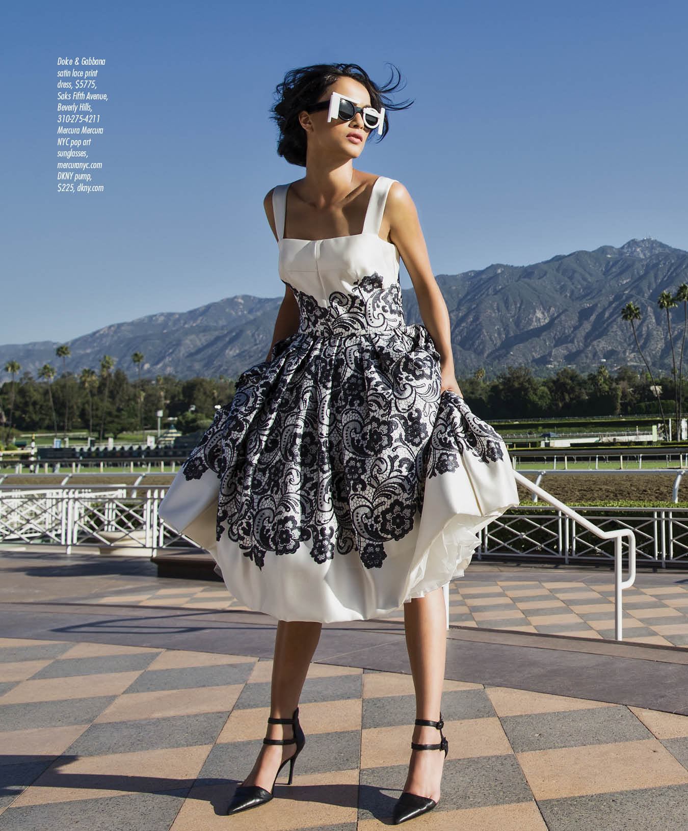Okay, so the shot I decide to show you doesn't have a horse in it. Well, not true. This is the left side of a spread. The horses are on the right hand page. Angela Jonsson / VIsion Models in Dolce & Gabbana satin lace print   dress, $5775,   Saks Fifth Avenue,   Beverly Hills,   310-275-4211;   Mercura Mercura   NYC pop art   sunglasses,   mercuranyc.com   DKNY pump,   $225, dkny.com
