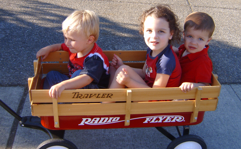 The objective is to safely and comfortably seat 3 children in a wagon.