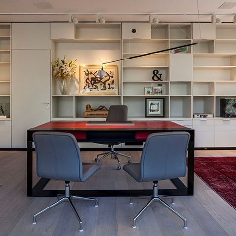 #office #officedecor#architecture #decor #red#ingomaurer #ingomaurerlamps #lighting #bookshelves #art#christianliagre #desk #antiquerug #lightingdesign #badesign#miami