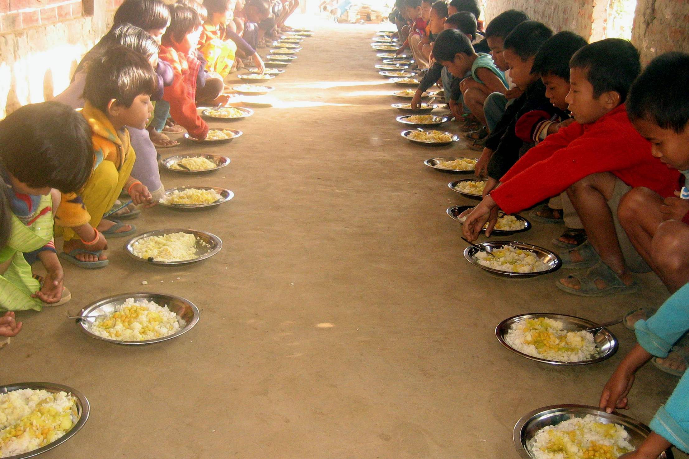 Main 4 Antioch School Child pray,eat on floor HOME-100_Final CROP 1500X1000.jpg