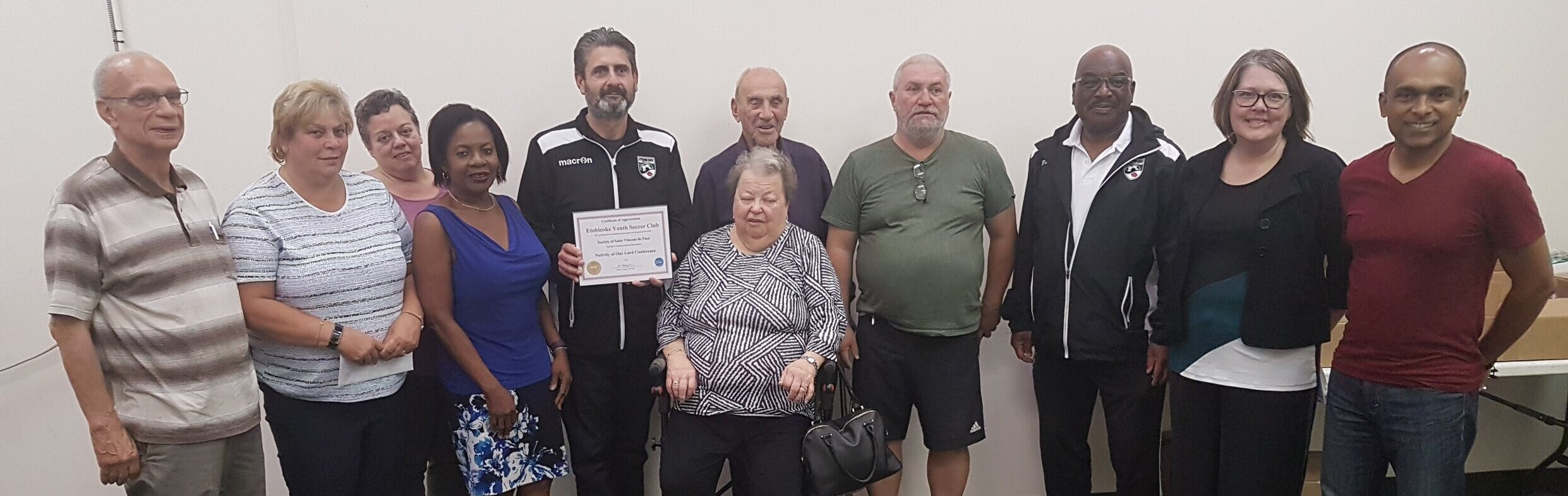 EYSC Board Members receiving a plaque of recognition from the Society of Saint Vincent de Paul for our community contribution.