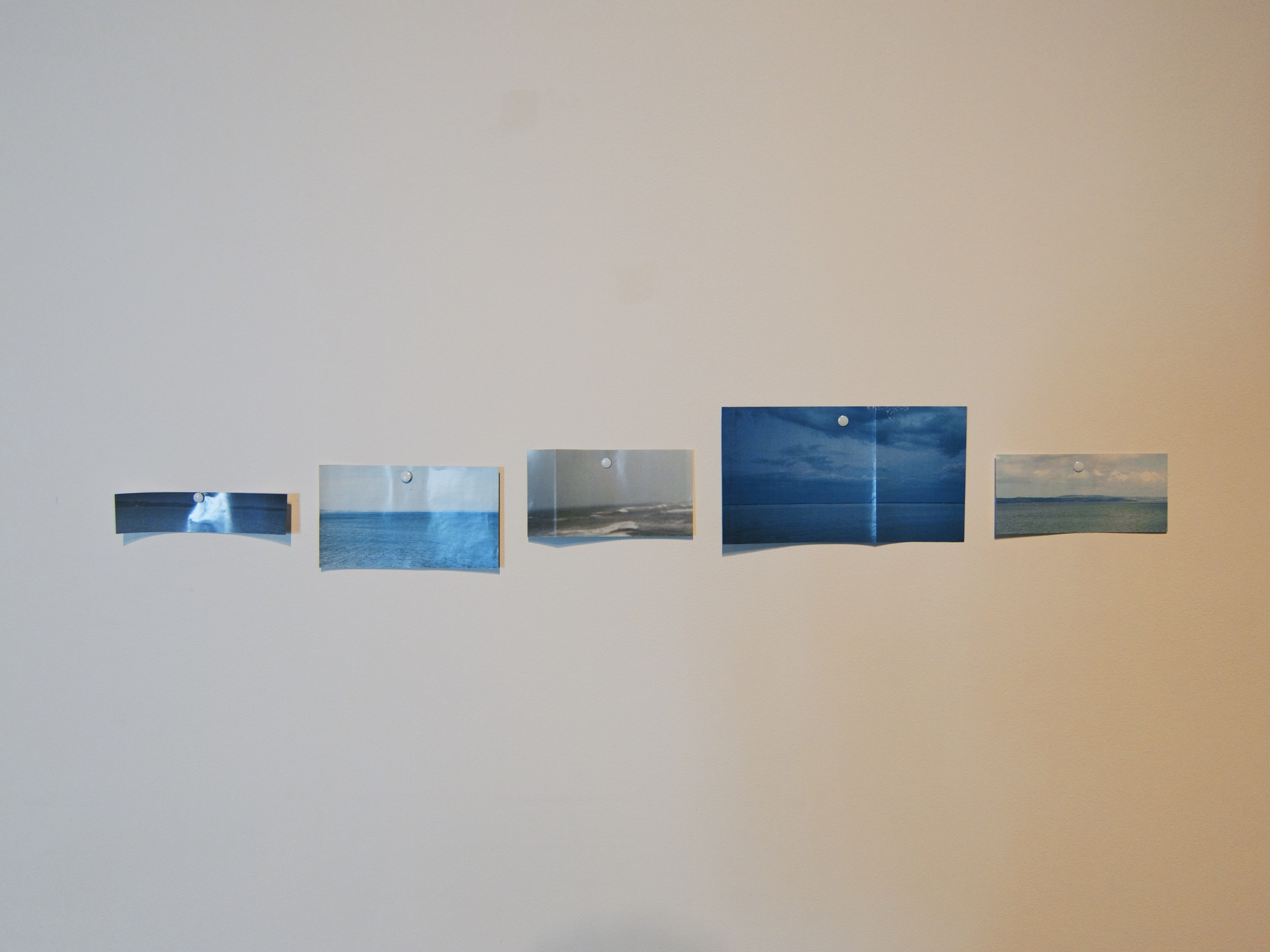 Pinned cut out National Geographic images of horizons, 20x6 inches, 2014.