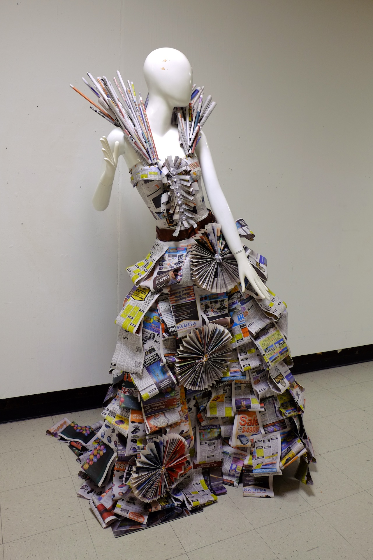Made at University of Texas at El Paso in Introductory Sculpture, newspaper advertisements draped over dress model, 6x3x4 feet, 2015.
