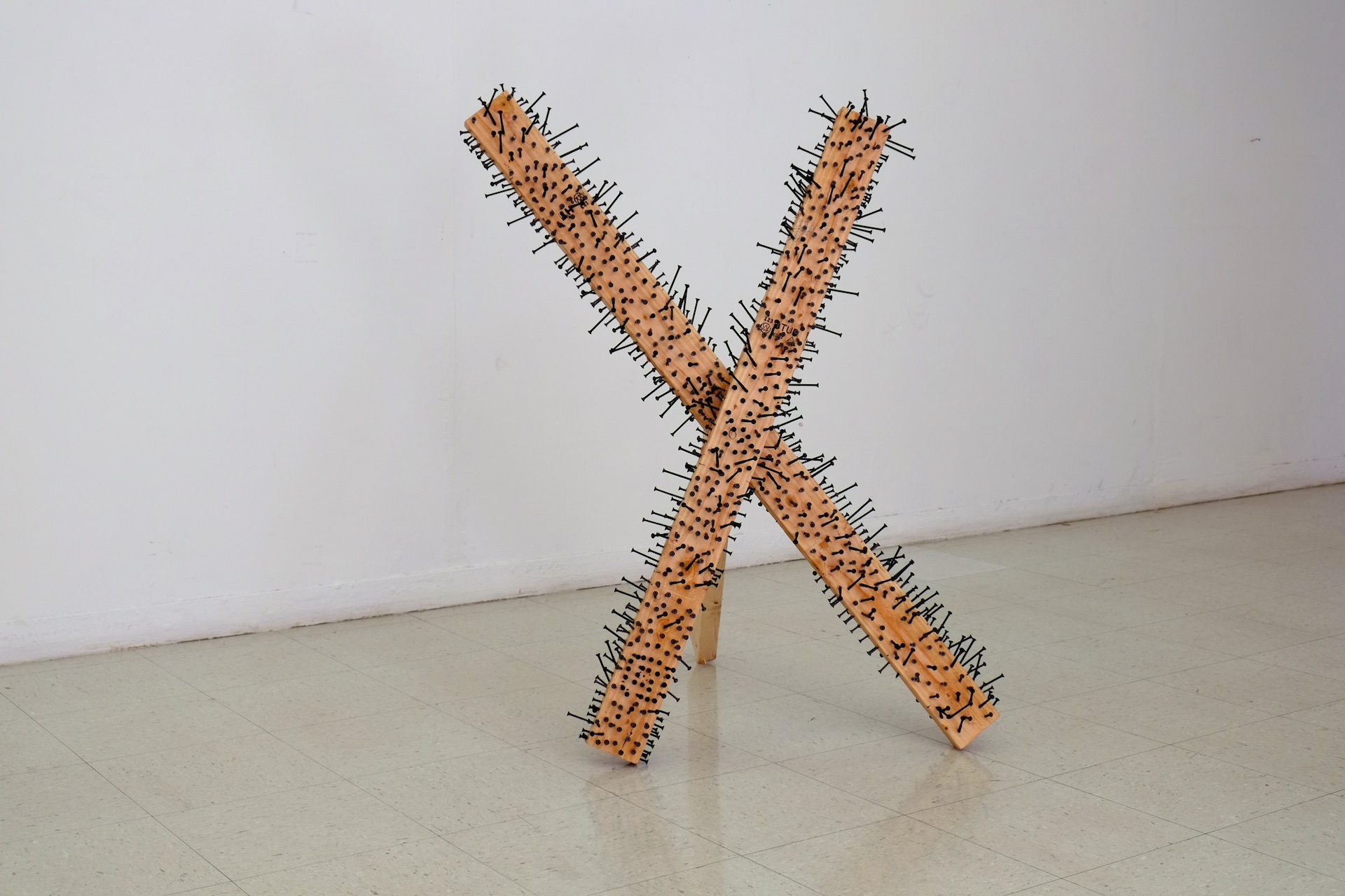 Made at University of Texas at El Paso in Introductory Sculpture, single 2x4 and 1,000 screws, 36x36x36 inches, 2016.