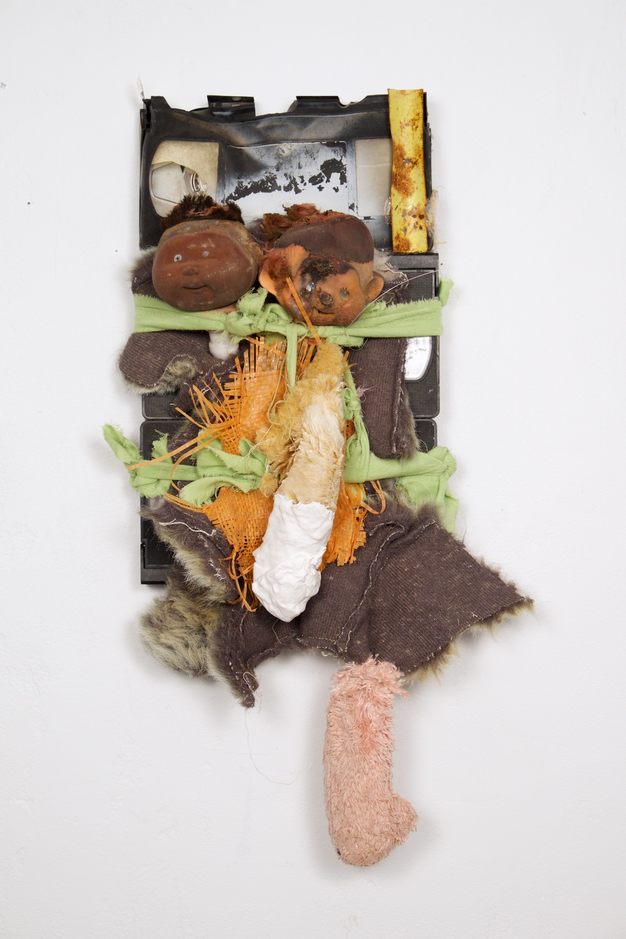 Made at University of Texas at El Paso in bricolage(assemblage)/mixed media, trash found at illegal dump sites, 12x8 inches, 2016.