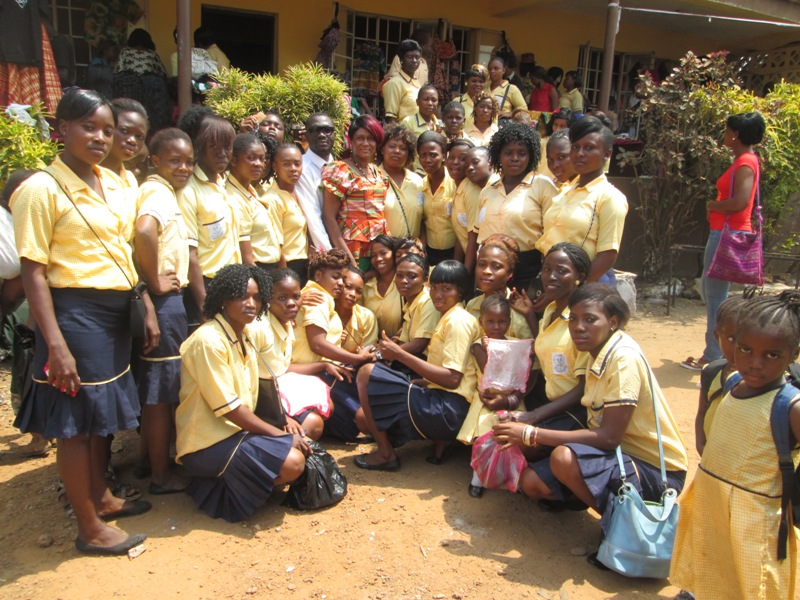 Esther Kanu (centre, red hair) with Staff, and Students of Women in Action
