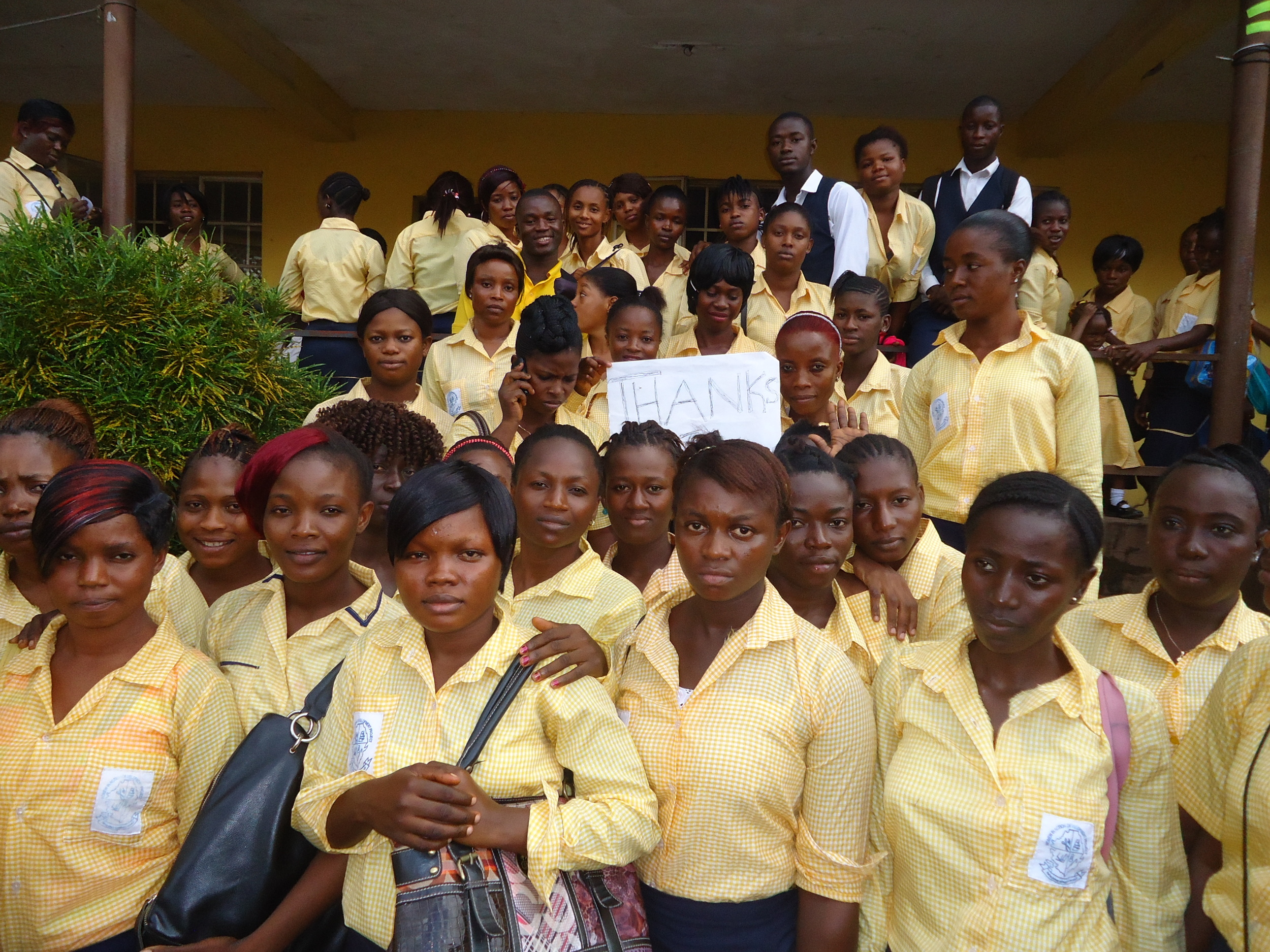 "Staff and Students of Women in Action hold a ""Thank you"" sign for the Esther's Echo 2014 fundraising campaing"