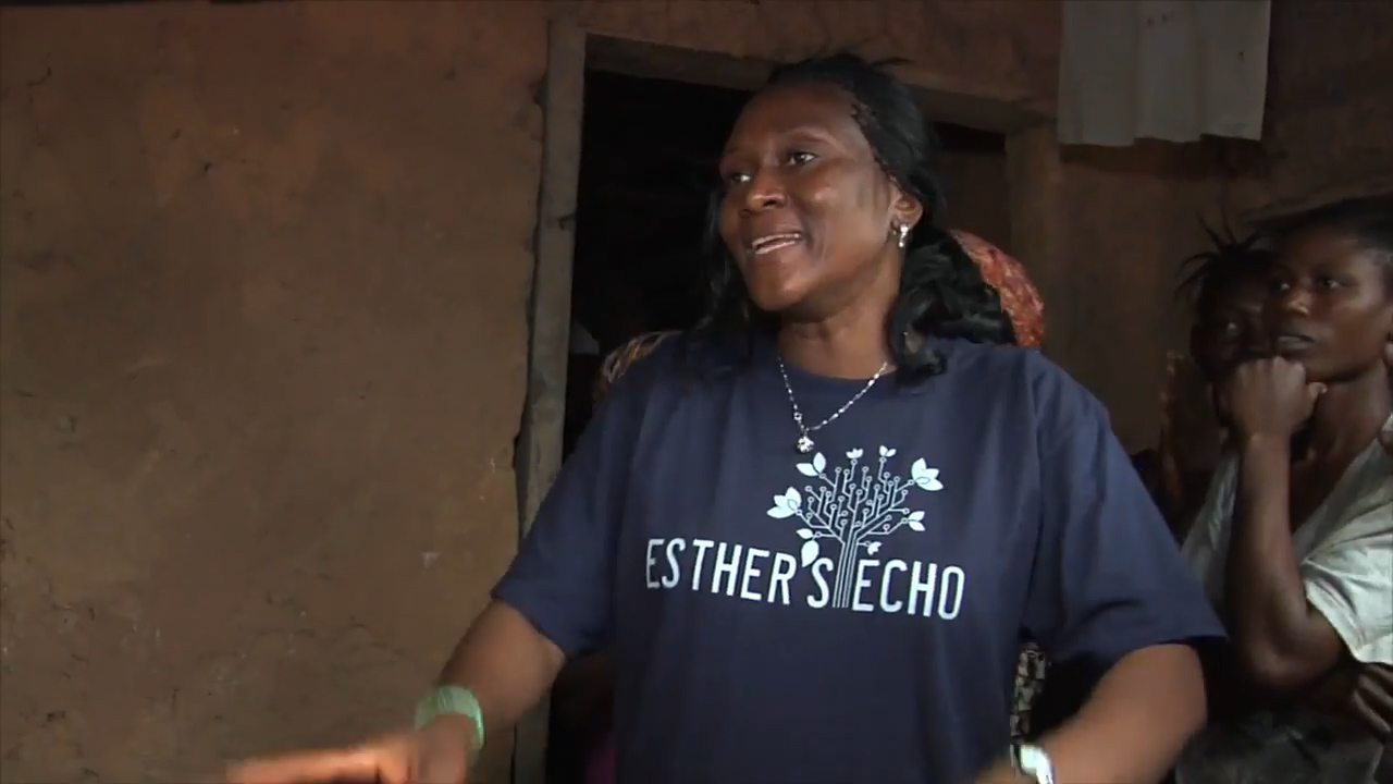 Esther visiting rural communities outside of Freetown to talk about Women in Action