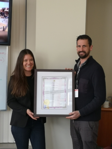 VanCityGives coordinator Amanda Burrows (left) with Vancouver City Councillor Michael Wiebe (right) with official municipal declaration of Giving Tuesday in Vancouver