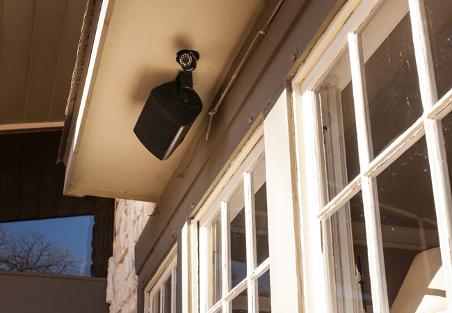 Outdoor Speaker and Security Camera Mounted Under Eve