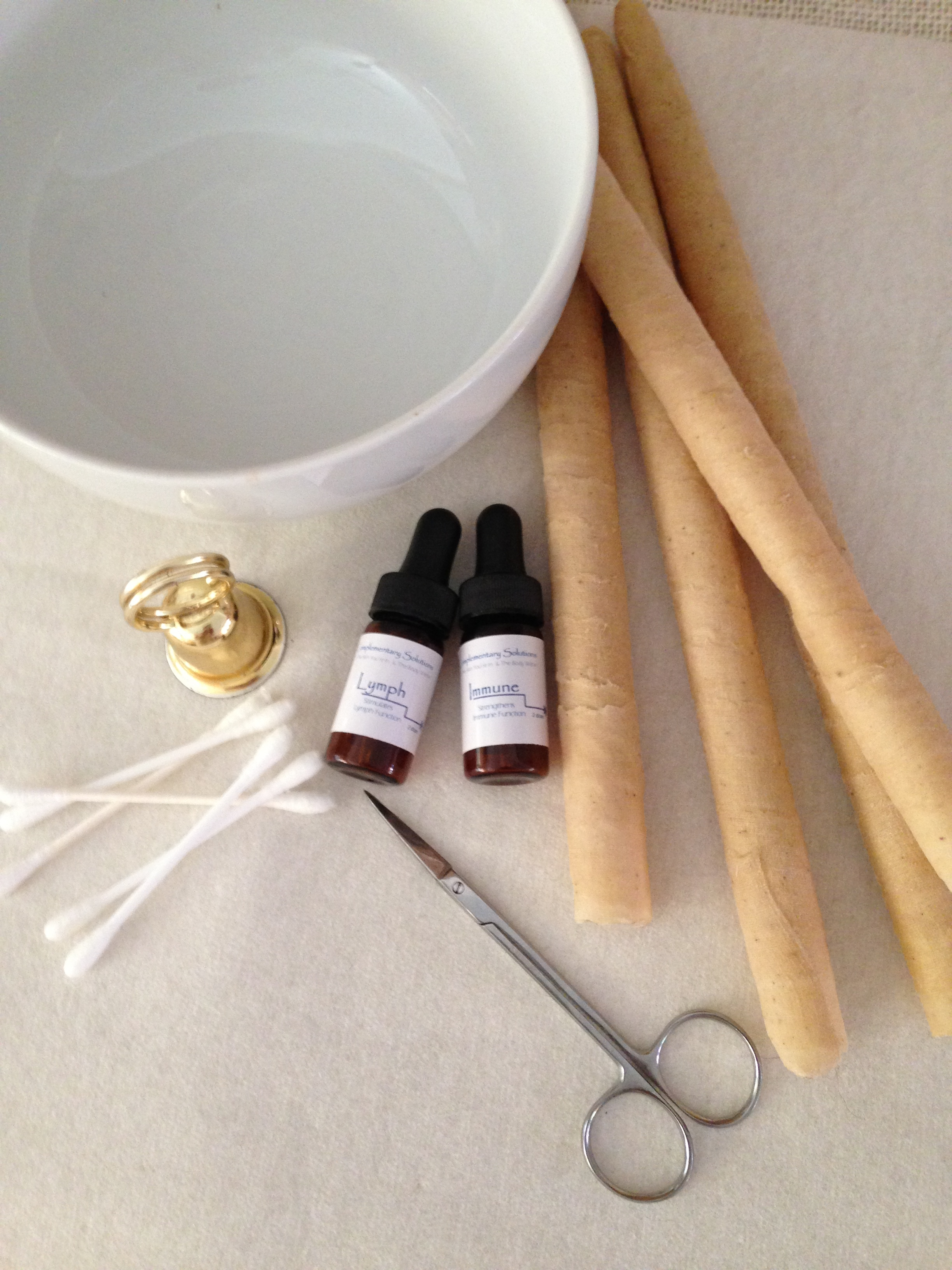 Ear Candles shown with Immune & Lymph  formulas  available for home use.