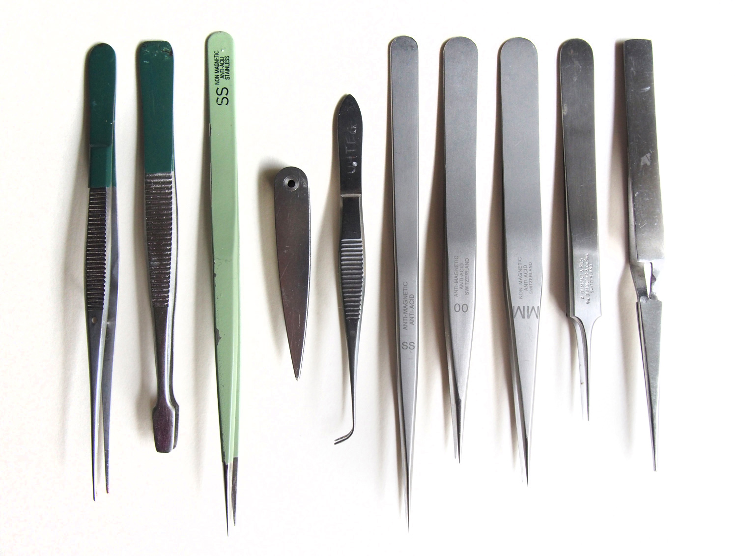 "Tweezers, largely ""borrowed"" from my dad, who used to be a doctor. The pale green one is the best; pointy but not too pointy, flexible but not too flexible, sleek. Regine, epoxy-coated stainless steel."