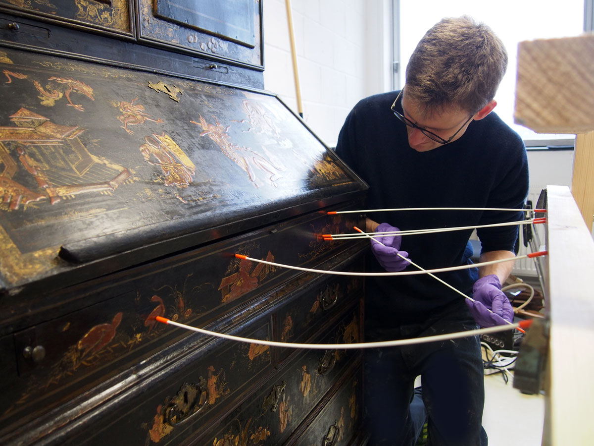 Areas of raised gesso decoration were consolidated and clamped using flexible shimbari sticks braced against a frame.