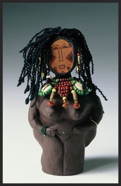 """Sistah Rosie. SHE POT Clay Sculpture. (c) Kaitha Het Heru. 8""""H. Fimo Oven-Fired Clay. Painted Leather Face. Wool Hair. Bead Adornment."""