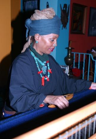 "Kaitha Het Heru weaving Khamit Nit Men: Khamit Cloth on her 4 harness, 45"" Floor Loom. Photo: Kmur."