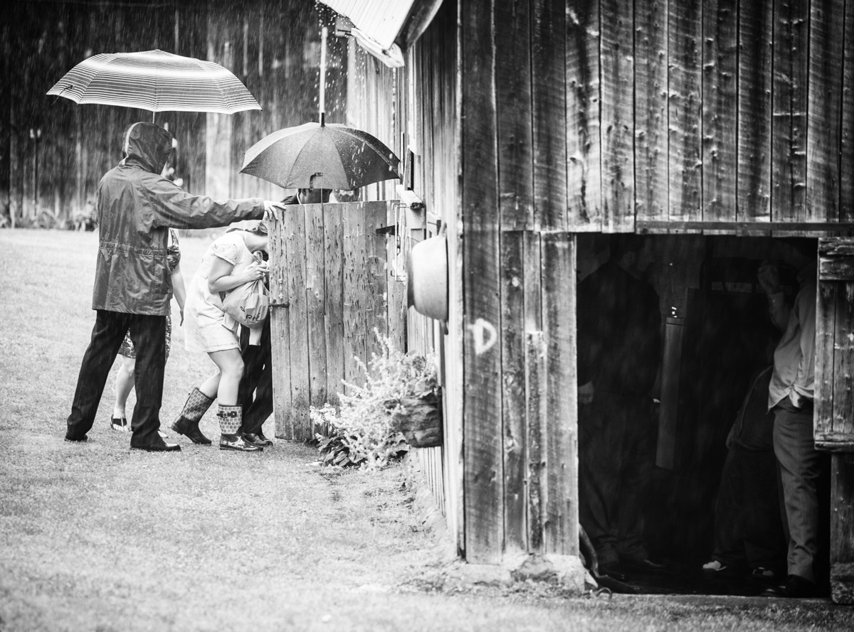 As guests arrived before the ceremony, they needed a place to find shelter. What better place then the huge barn. As a photographer, it is moments like these that you have to really pay attention to. They are priceless.