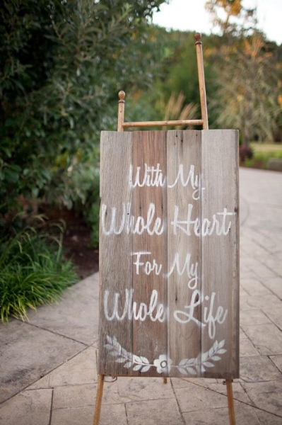 Custom, hand painted sign using reclaimed barn wood. Photo courtesy of Jamie Zanotti Photography.