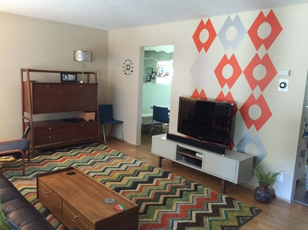 A fun room refresh full of pattern and color. Featured here, our geometric wall decals in orange and metallic silver. . Photo credit: Nadene Heckelman