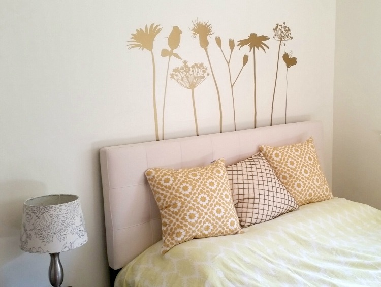 Bring the outdoors in for a simple update to any room. Our Wildflower wall decals are shown here in metallic gold and come prearranged as shown. Photo credit: Rachel Goodman  http://www.wallstargraphics.com/rustic-woodland/rustic-flowers-wall-decal
